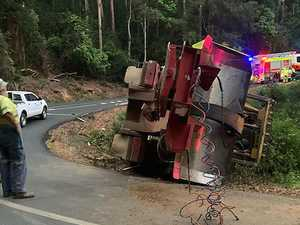 Dramatic truck rollover causes chaos