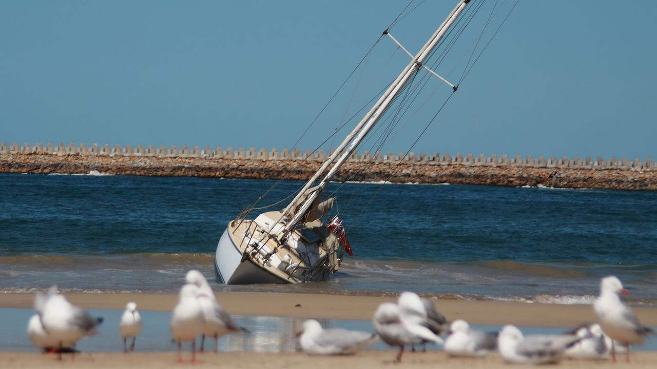 Seagulls watch on as the yacht takes on water, no doubt relieved their lack of fingers means they won't be accused of bad knot tying. Photo: Frank Redward