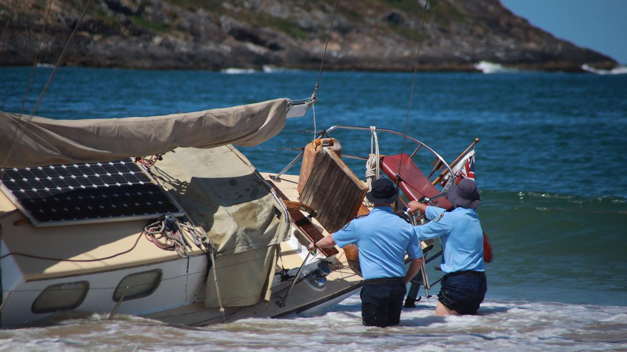 Water police hold the yacht in place while the skipper heads into town. Photo: Frank Redward