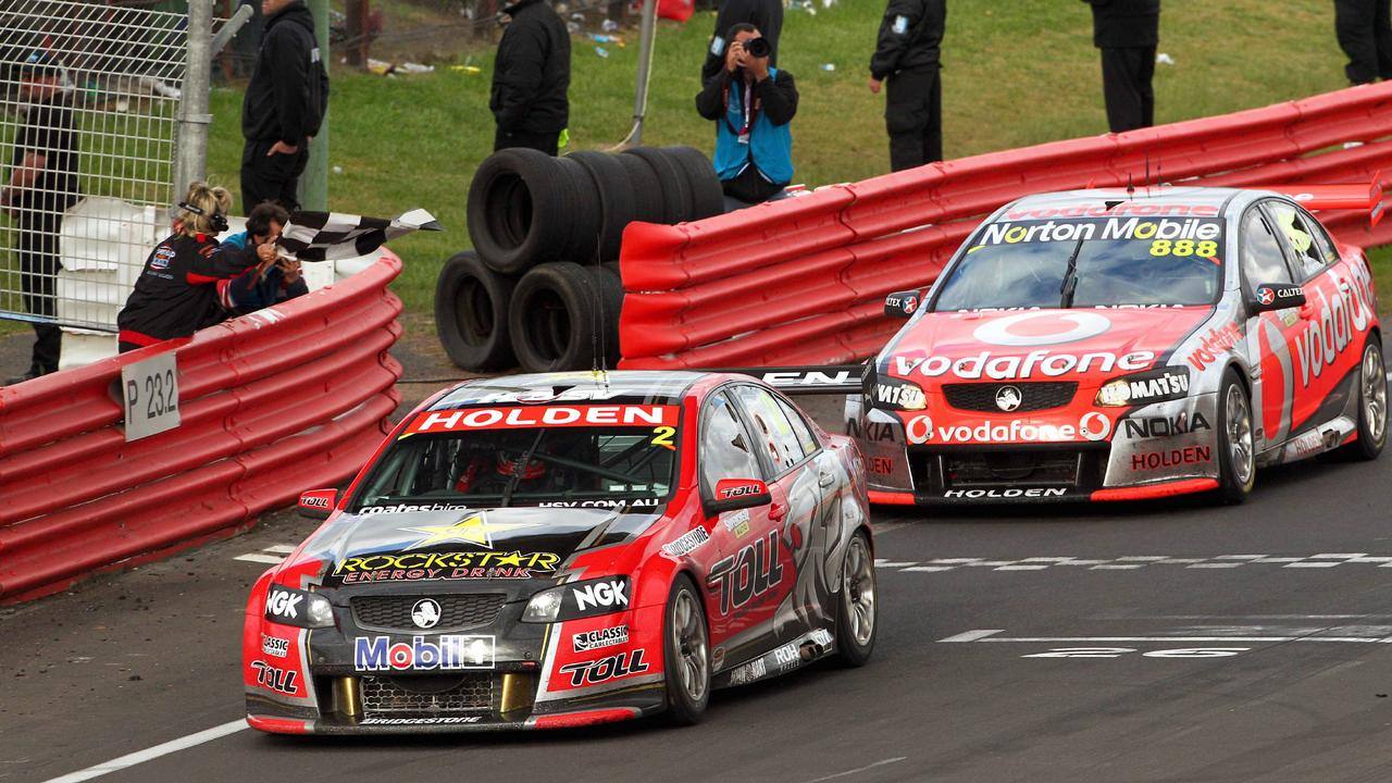 Garth Tander pips rival Craig Lowndes to win the Bathurst 1000 in 2011 at Mount Panorama in Bathurst, NSW.