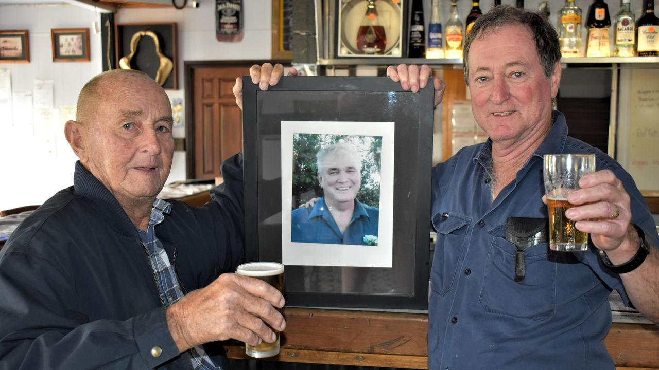 Loyal fans of the Hotel Eton Eddie Sutton and Wayne Tucker toasting former publican and owner Lance Cameron. Picture: Heidi Petith