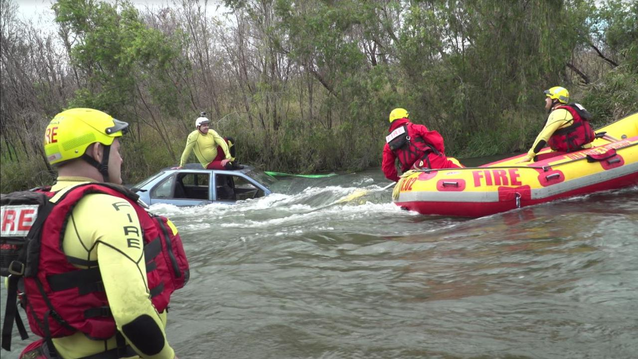 Queensland Fire and Rescue Service Swift Water development trainers gathered at Wivenhoe Dam to simulate scenes resembling real emergencies and design new training sessions.