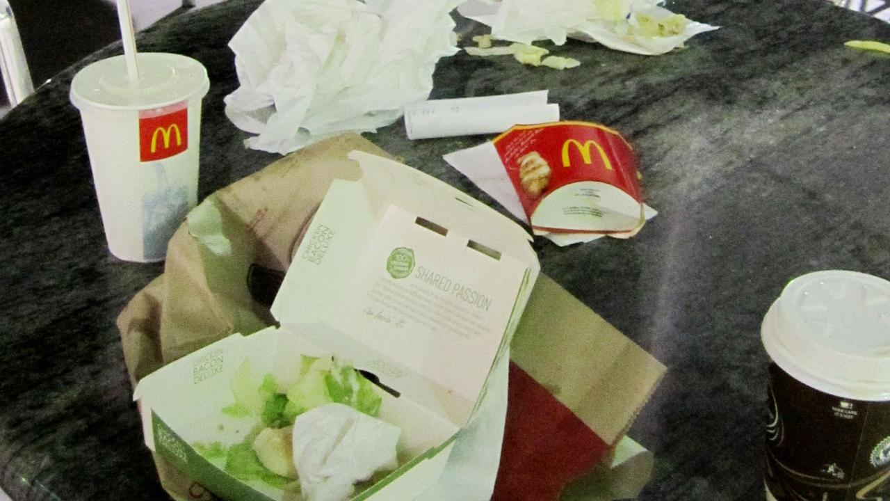 Litter left on tables at McDonalds.