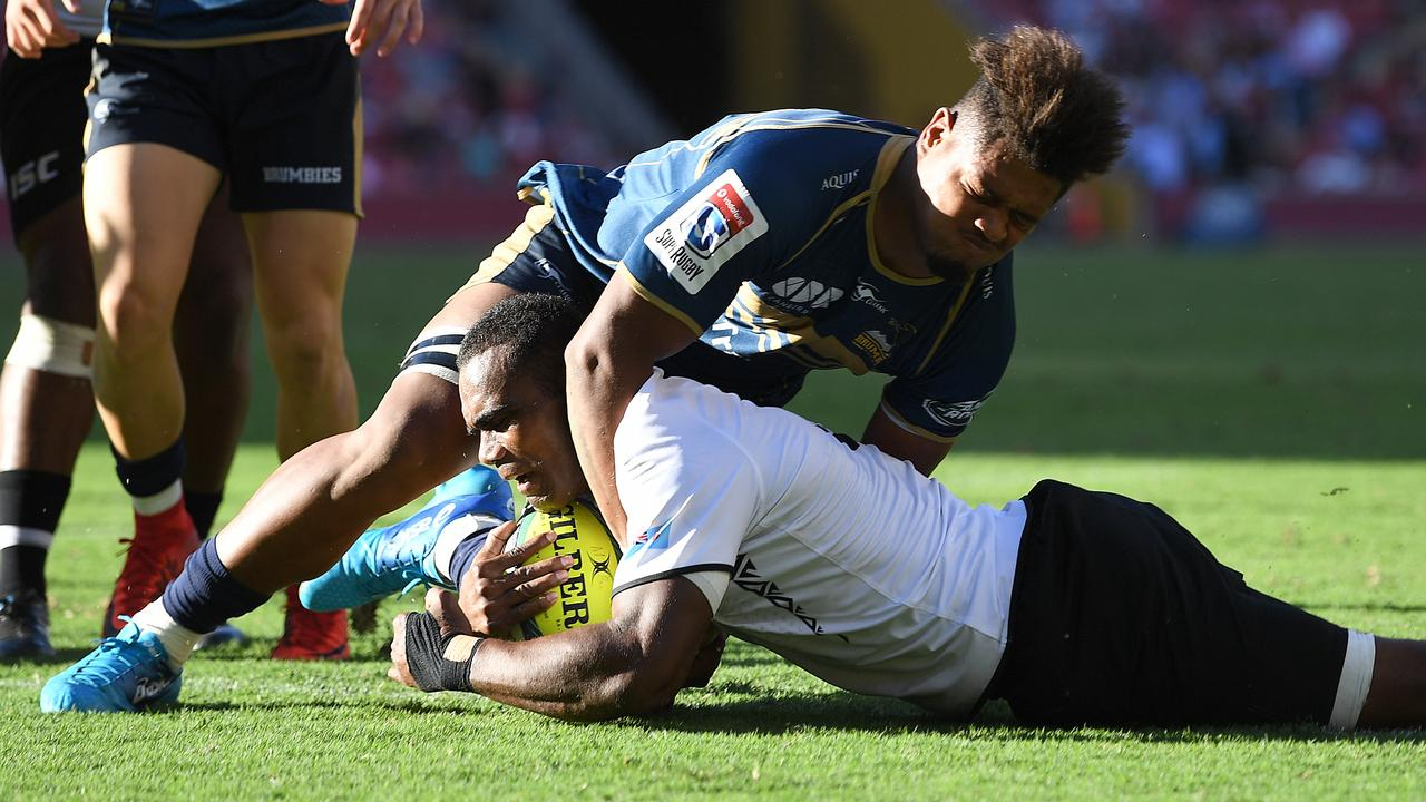Rob Valetini of the Brumbies fails to prevent Mosese Voka of Fiji from scoring a try during the Global Rugby Tens match in 2018. Picture: Dave Hunt