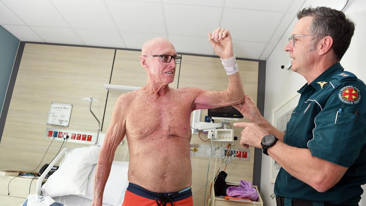 Massive heart failure survivor Greg Messer recovers in Sunshine Coast University Hospital. Pictured, Greg Messer, left, and Queensland Ambulance Service clinical director Tony Hucker. Photo Patrick Woods / Sunshine Coast Daily.