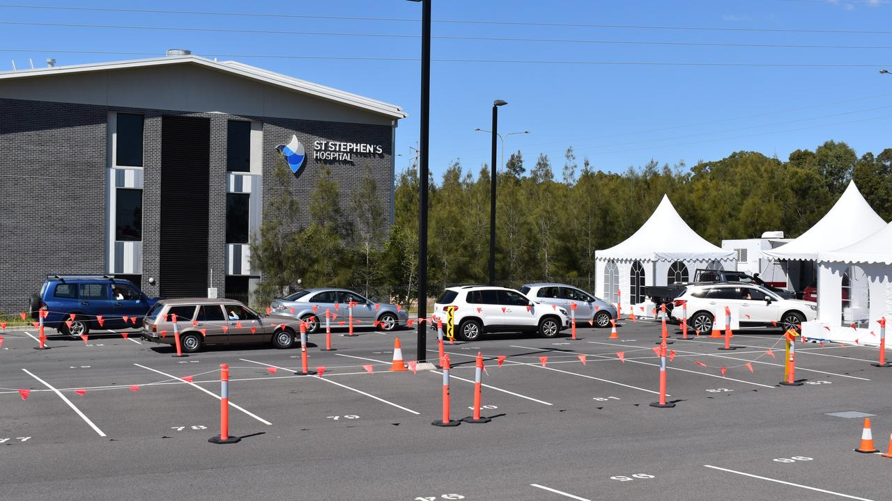 People wait in their cars to be tested at the Hervey Bay fever clinic.