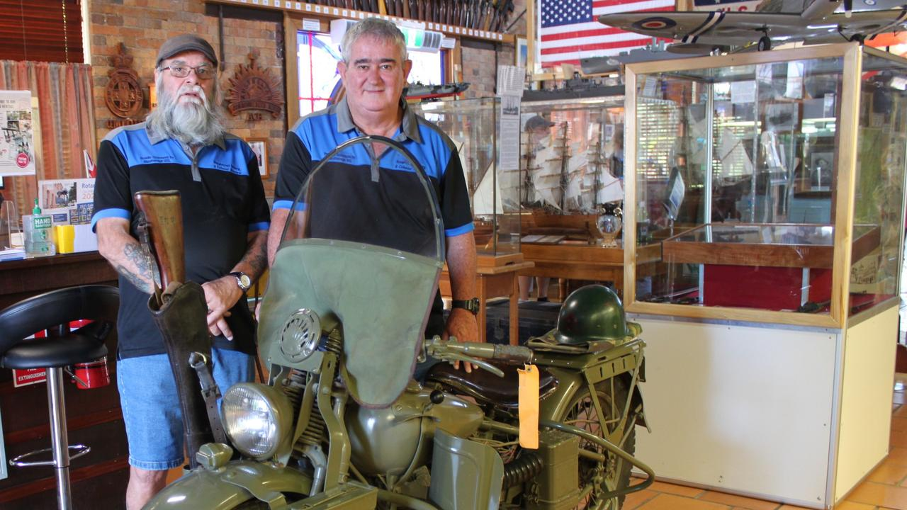 Barry Stanberg and Steve Webb with a 1942 Harley Davidson at the Maryborough Military Museum.