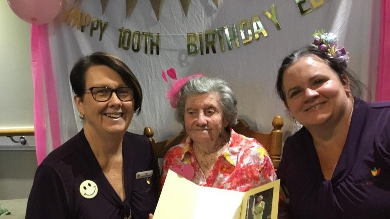 Elvie Brown with New Auckland Place staff and co-residents celebrating Elvie's 100th birthday.