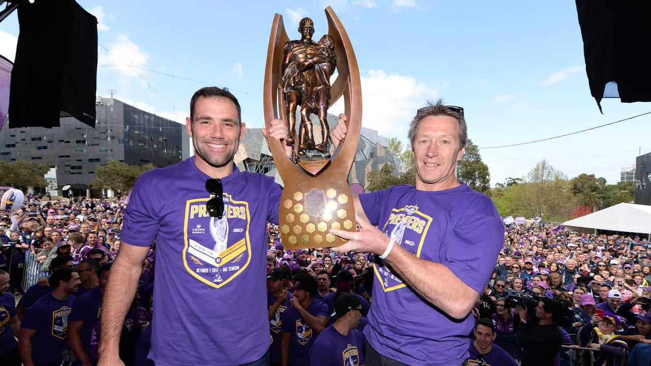 Storm captain Cameron Smith and coach Craig Bellamy hold up the trophy at Federation Square in 2017. Picture: AAP Image/Mal Fairclough