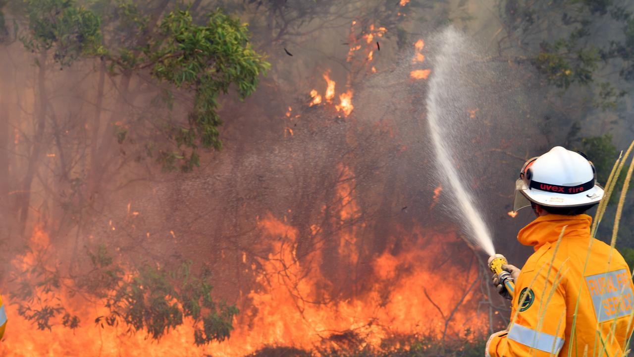 Emergency crews battle the fire at Peregian Springs last year. Photo: John McCutcheon.