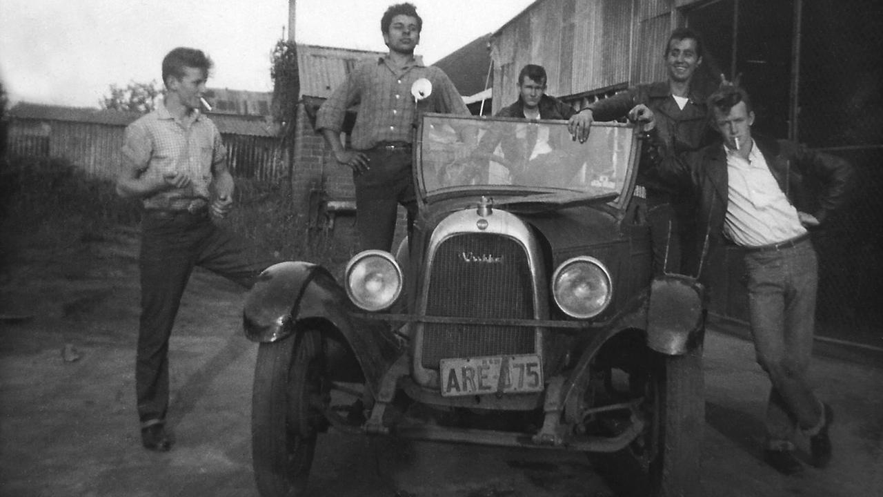Life was always a bit of a joke ... Paul Hogan (right) and mates with car, circa 1956.