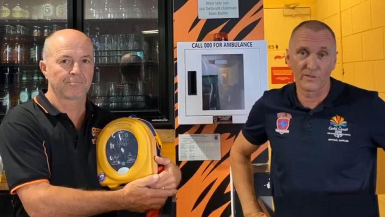 Slacks Creek Football Club President Steve Webb and Scott Wimpey of First Aid Accident and Emergency discuss how a teenage boy was saved using the club's defibrillator machine in this still from a YouTube video. Picture: YouTube