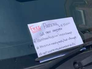 Parking note left on car divides