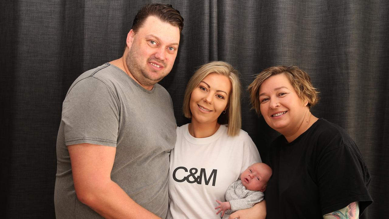 Armstrong Creek's Anthony and Jess Armistead, left, have welcomed miracle son Logan – birthed by Jess' surrogate sister Kylie Jablan. Picture: Alison Wynd