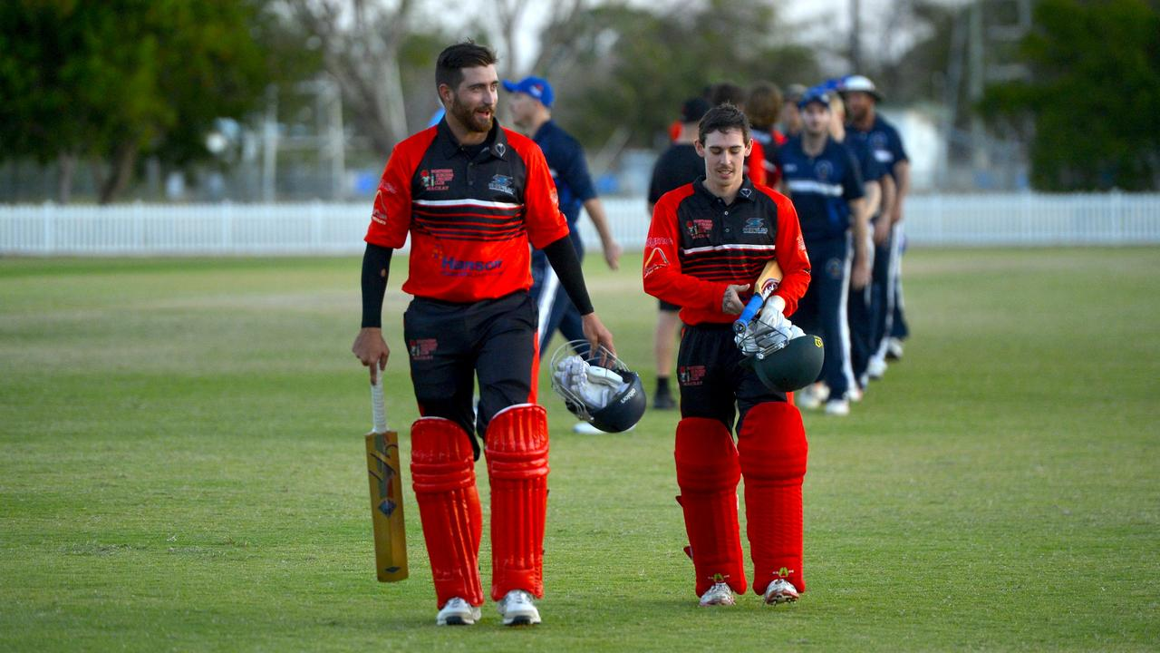 Norths defeated Brothers by one wicket in Round 2 of the DBCT Poole Cup at Harrup Park. Norths' Conor Bryant (left) walks off with teammate Blair Holden after hitting the winning runs. Photo: Callum Dick