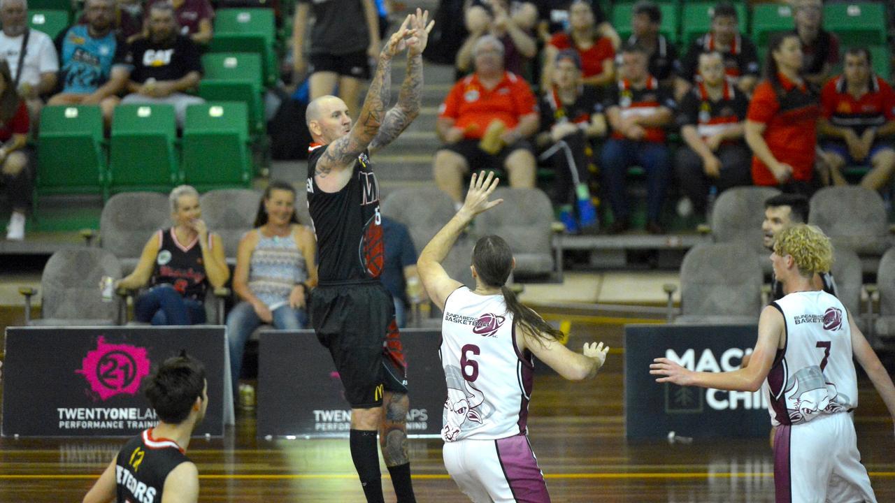 The Mackay Meteors defeated the Bundaberg Bulls 109-37 in Round 2 of the ConocoPhillips CQ Cup at Mackay Basketball Stadium. Brad Rasmussen shoots. Photo: Callum Dick