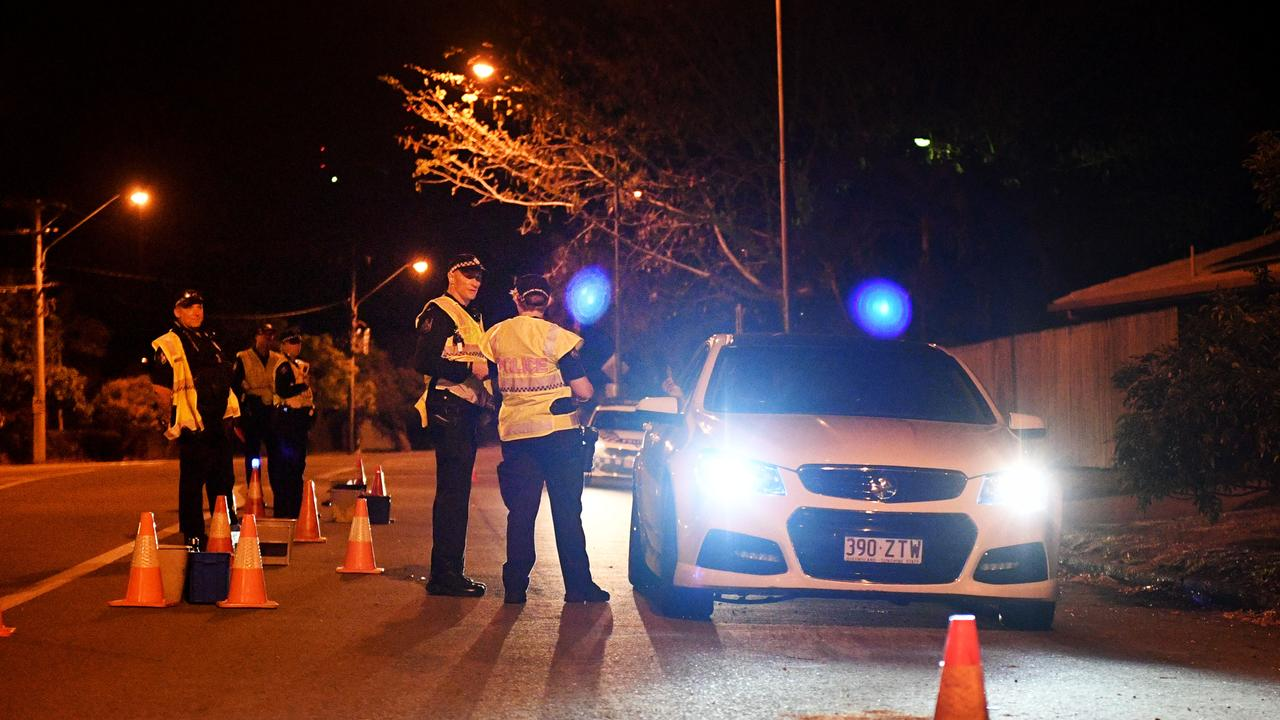 Police conduct a late night breath test.