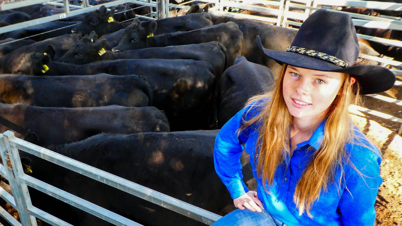 Erin McCormack with some of her family's Angus heifers and calves. Picture: supplied