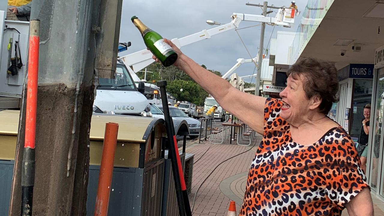 "Ruth Modin celebrates the removal of ""ugly"" and potentially dangerous power poles from the main street of Rainbow Beach."
