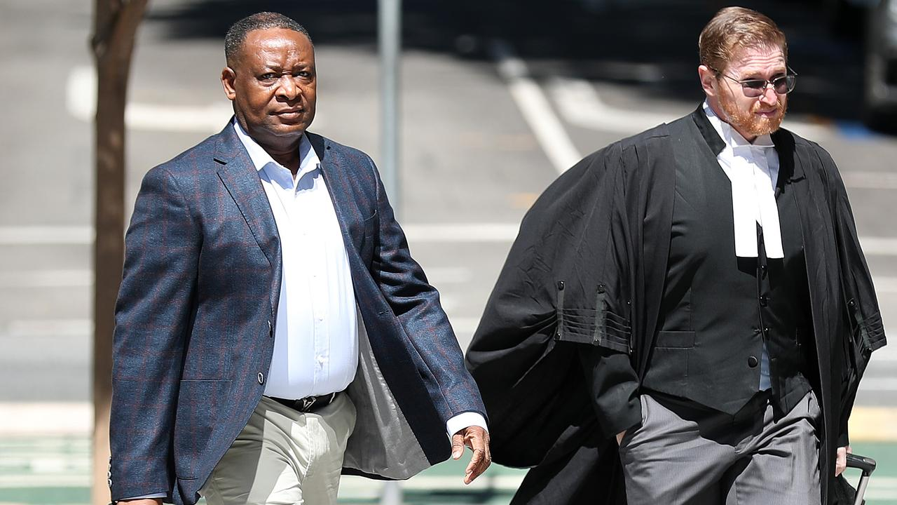Doctor Olajide Ogunseye arrives at Brisbane District Court with his barrister Angus Edwards. Picture: Liam Kidston.