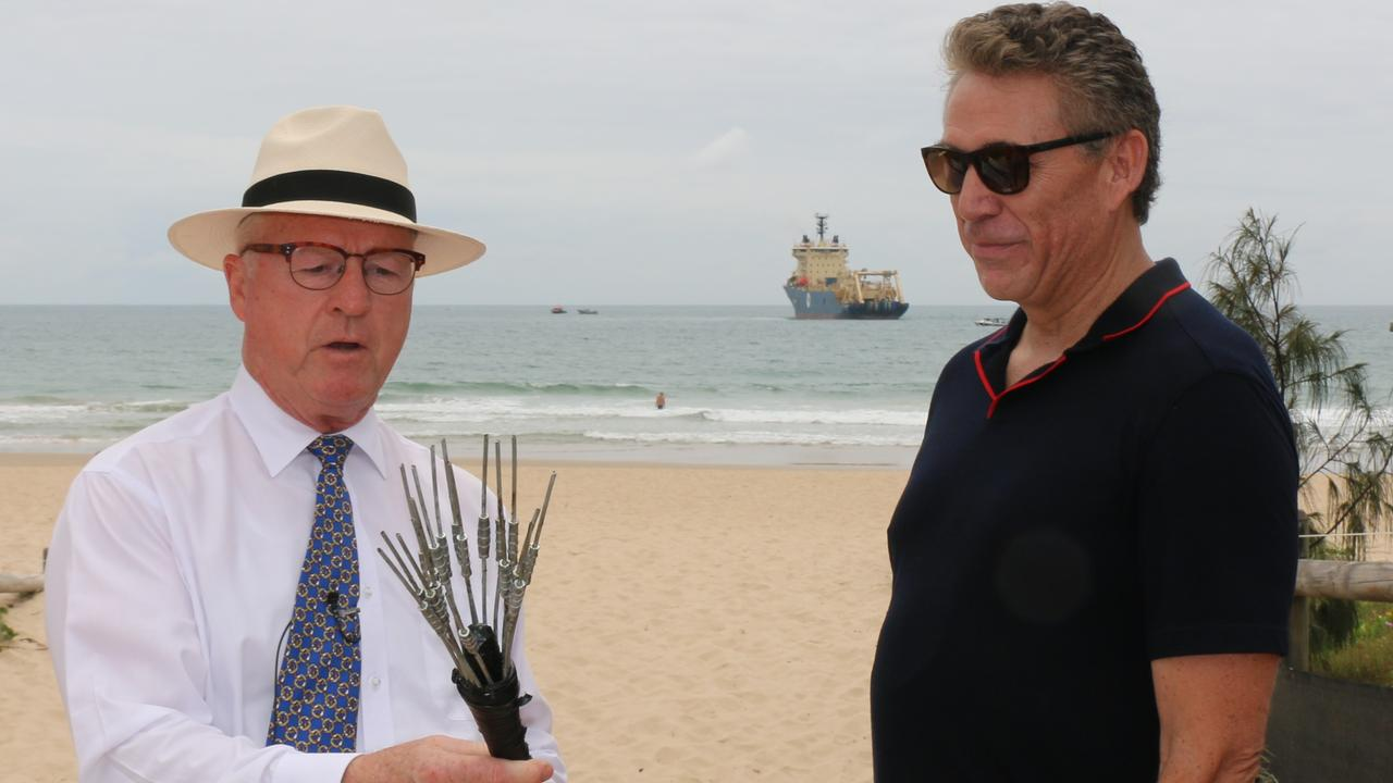Sunshine Coast Council Mayor Mark Jamieson and RTI CEO Russ Matulich with the cable at Maroochydore.
