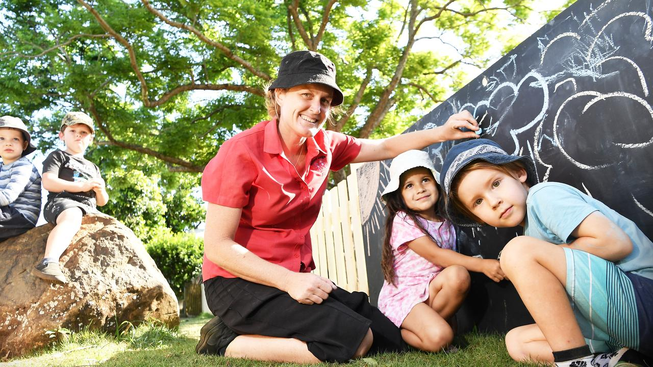 Milford Lodge licensee Molly Stewart helps Eden Yandall and Fletcher Boardman decorate and outdoor chalkboard. Picture: Patrick Woods