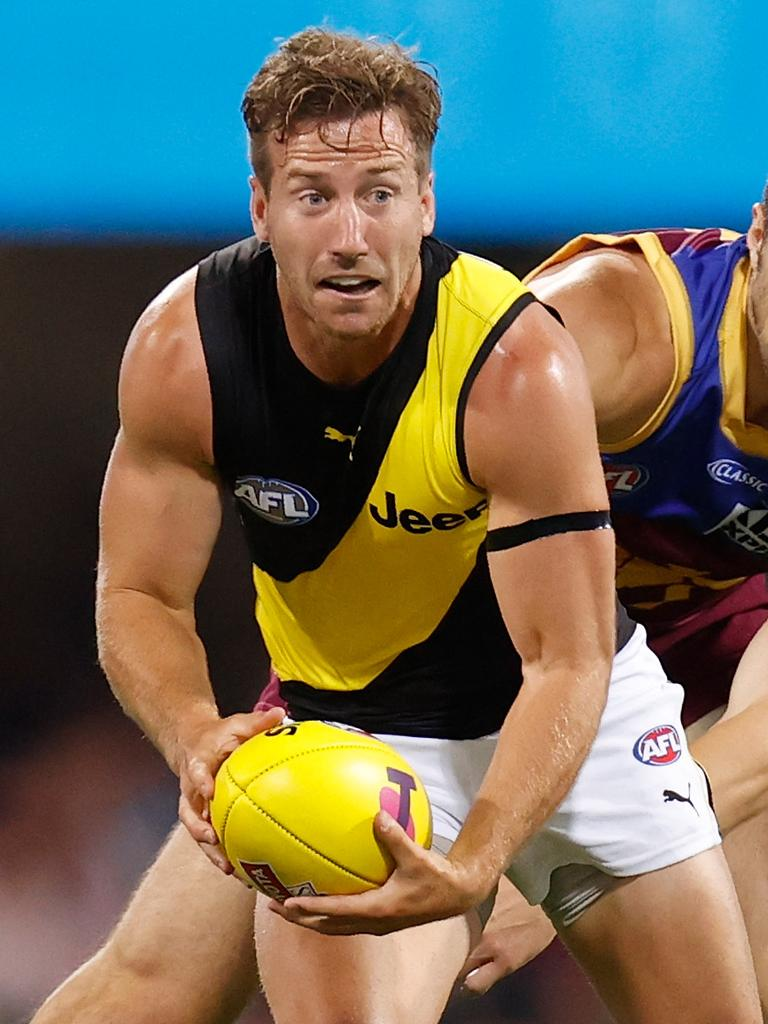 Kane Lambert plays a key role releasing teammate Dustin Martin.