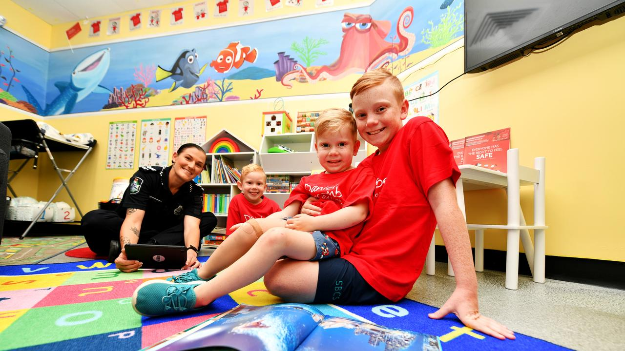 Townsville Police opening up a special room for kids at the Townsville City Police Station. Senior Constable Jodie Petersen with Brett 5, Will 4 and Zac Stephenson 11. Picture: Alix Sweeney