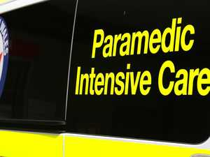 Paramedics assess patients on scene of two-car crash
