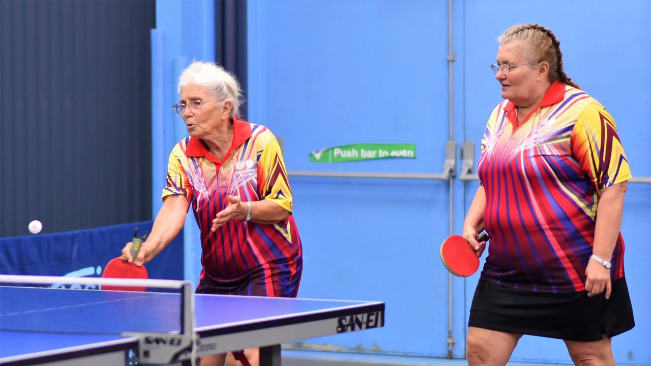 Coral Morgan, 79, plays with her daughter Delma Knight during the Mackay Closed table tennis championships.