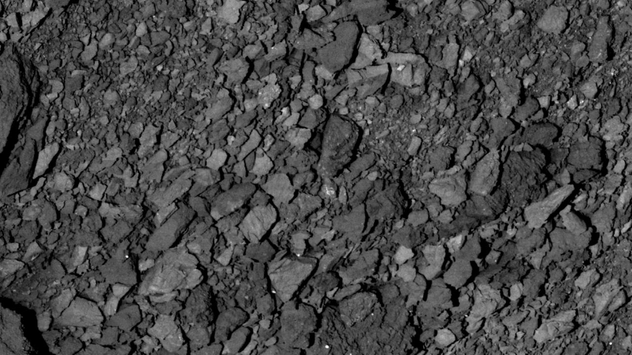 Asteroid Bennu ejecting particles from its surface. Picture: NASA.