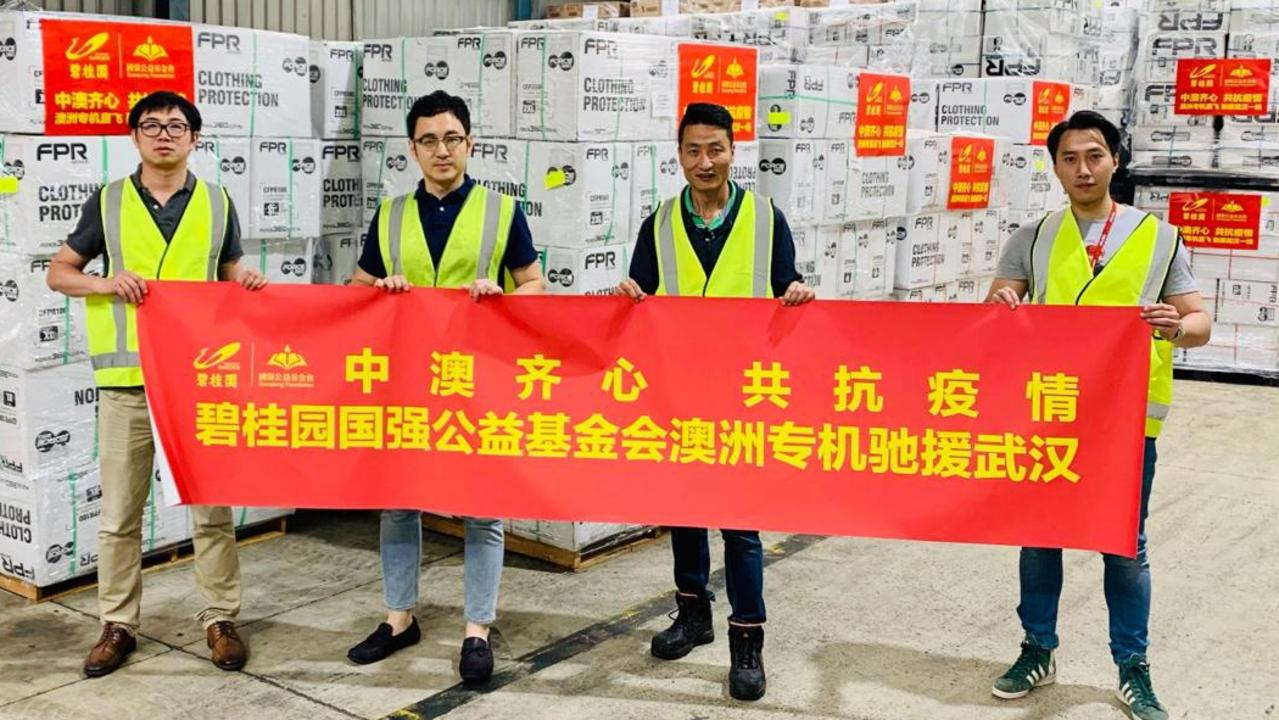 Medical protective gear sourced in Australia and shipped to China in February. The banner states: China-Australia work as one together to fight the pandemic. Picture: Linkedin
