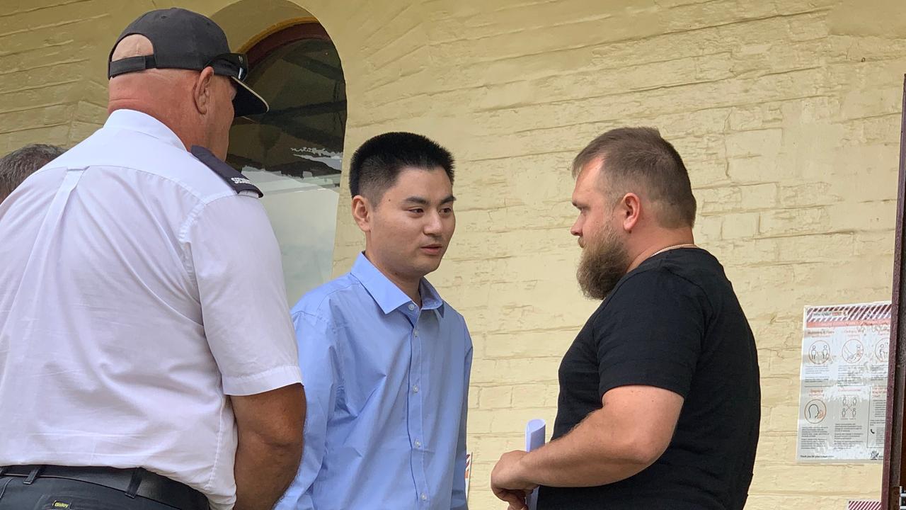 Xi Ling, left, apologises to Tim Kay, son of crash victim Rhonda Kay, outside Maryborough Magistrates Court.