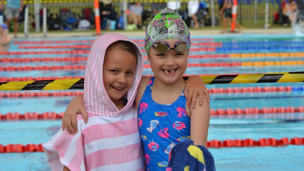 Cannonvale Cannons swimmers Evie Doherty and Koa Harland at the GBR Swimming Carnival in Mackay. Photo: Contributed