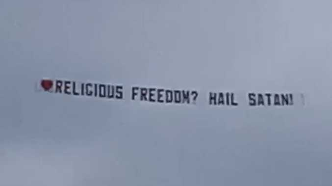 Speak of the devil: Controversial banner takes to the skies