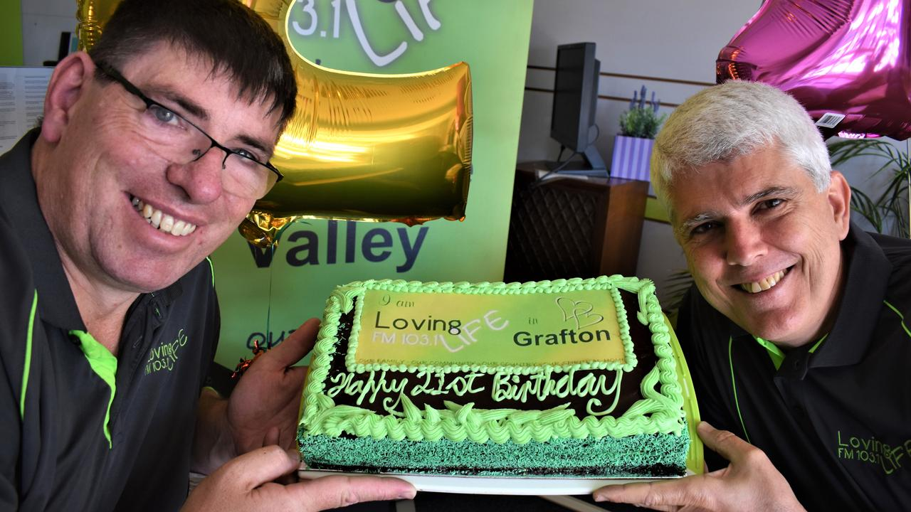 Loving Life FM station manager Damien Fisher and president Adam Cinzio celebrate 21 years on air for the Grafton-based community radio station with the cake courtesy of Grafton Bakery.