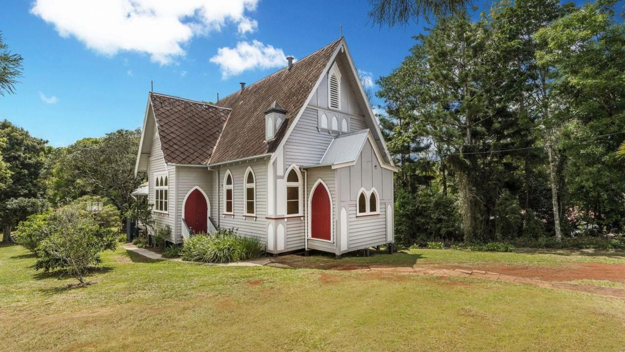 HEAVENLY HOME: An architecturally significant church has been refurbished into a lovely three bedroom home featuring cathedral ceilings, carved timber cabinetry, gleaming teak wood floorboards and stunning rosewood walls, gothic windows set in a parklike garden at Dunoon.