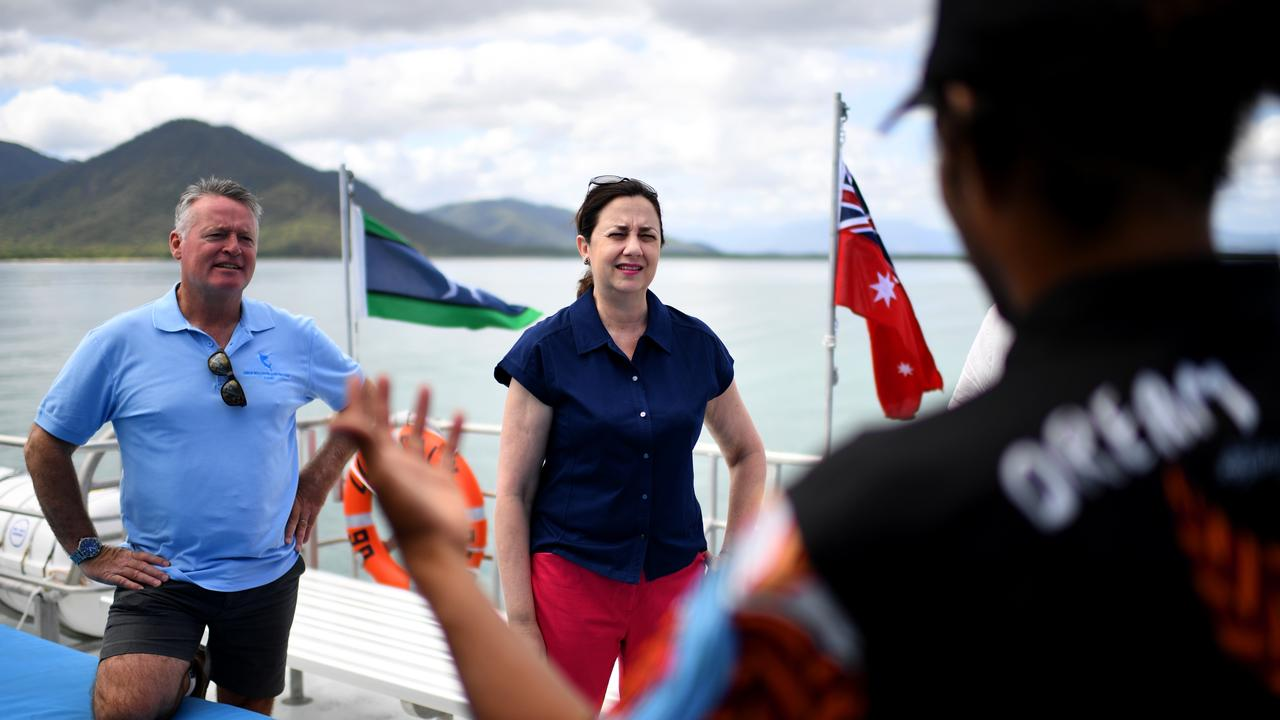 Premier Annastacia Palaszczuk and the Member for Cairns Michael Healy talk to an indigenous crew member onboard a reef cruise boat during a visit to Fitzroy Island, while on the election campaign trail. Picture: NCA NewsWire / Dan Peled