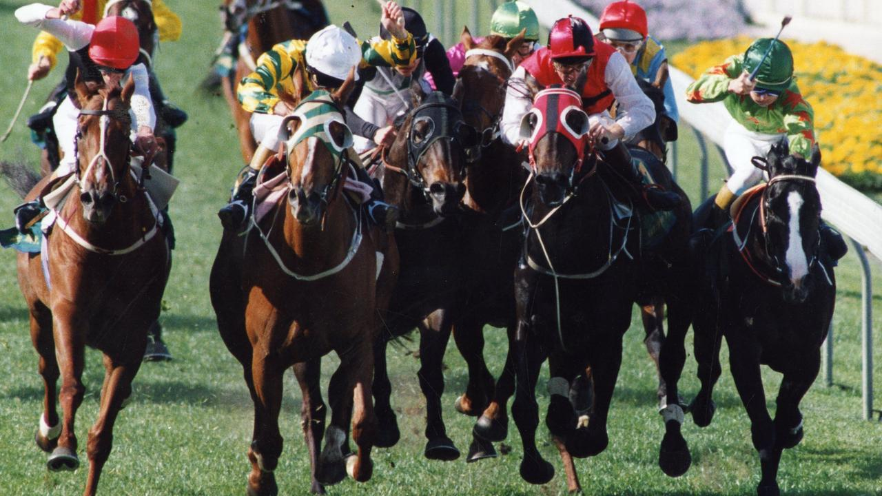 Super Impose (left) charges past Let's Elope (white cap) who tightens Better Loosen Up, which in turn gives Kinjite and Prince Salieri the shorten up. Picture: News Corp