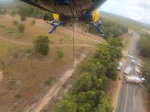 RACQ Capricorn Rescue approaches the scene of a crash at Tanby Rd.