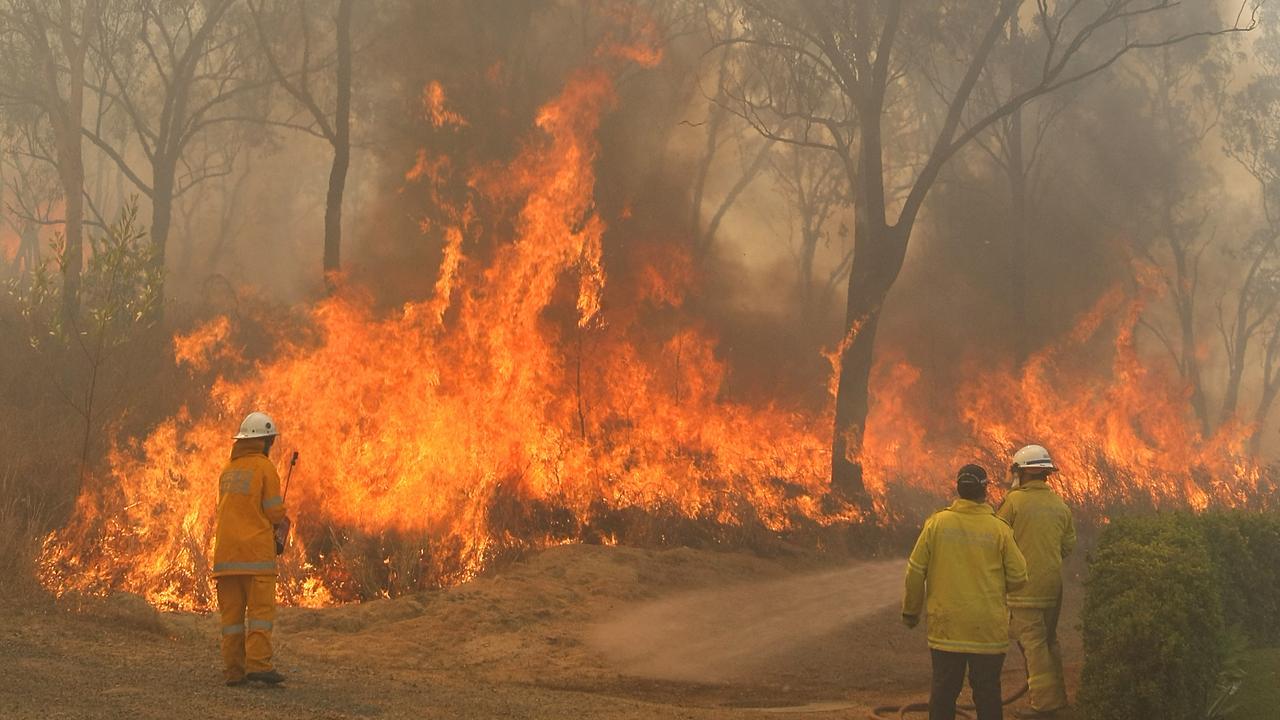 Fire fighters battle fires in Rockhampton last year.