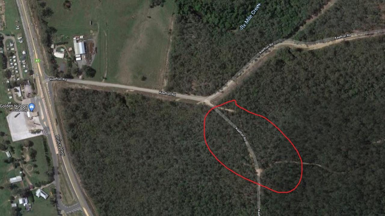 An aerial shot of Keefton Road coming off the Bruce Highway adjacent to the Gold Nugget service station, and the bushland where the human remains were found.