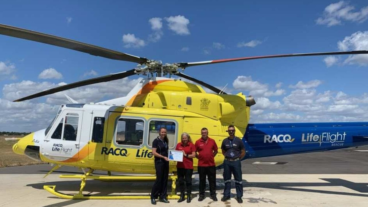 L-R: Life Flight Bundaberg crew member Steph McKenzie presenting Aramex Wide Bay Regional Franchisees Sue and Warrick Peake (in red) with a certificate of appreciation for their support of the RACQ LifeFlight Bundaberg inaugural Golf Day. Photo: Contributed.
