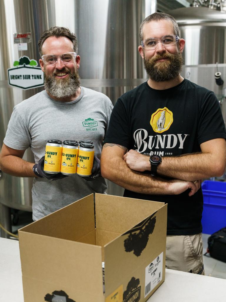 Eumundi Brewers Chris Sheehan and Allan Tilden at work in the Eumundi Brewery canning the new brew, Eu-Bundy IPA. Picture: Alain Bouvier