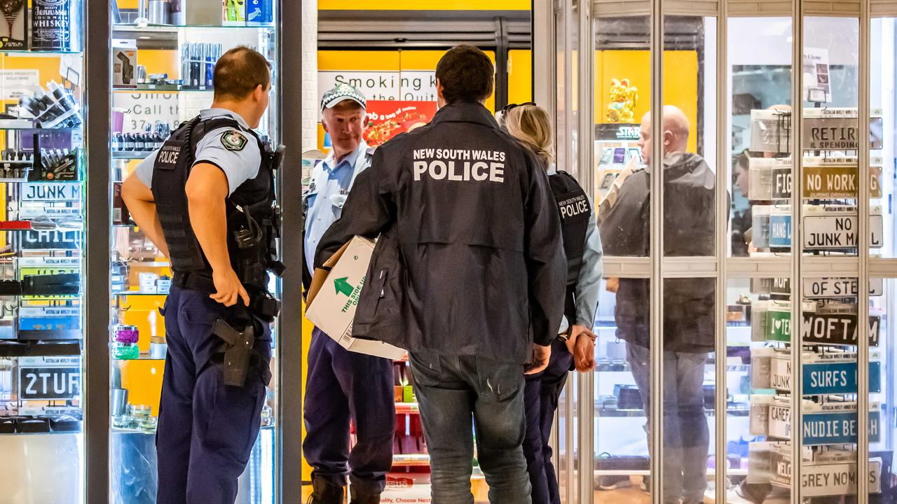 Police officers raid a Sydney tobacconist in 2019. Picture: AAP