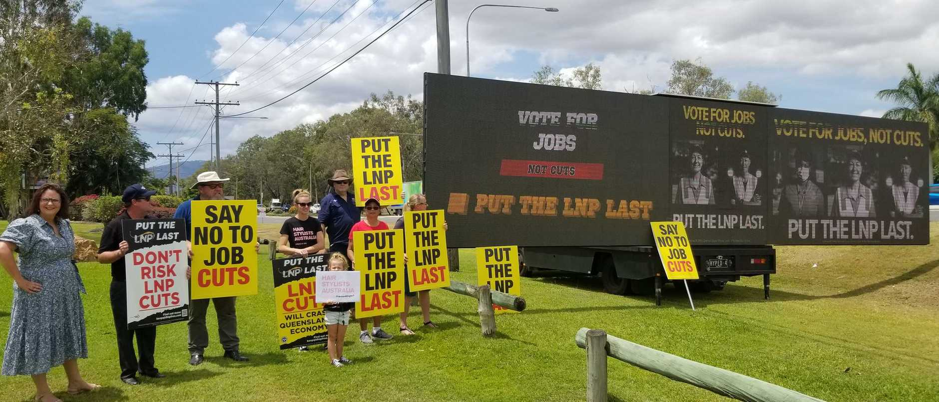 CAMPAIGN MESSAGE: Queensland Council of Unions President Kate Ruttiman and union supporters, unveiled a massive digital billboard in Rockhampton today.
