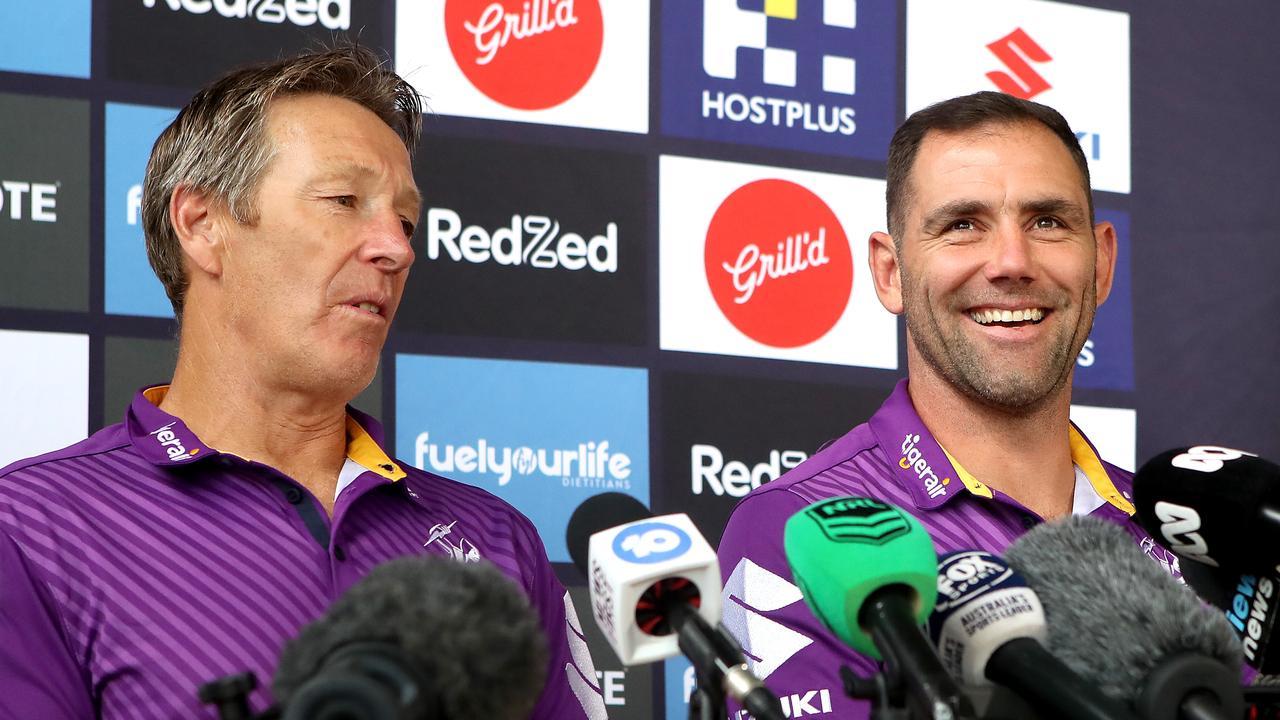 Melbourne coach Craig Bellamy and captain Cameron Smith. Photo: Jono Searle/Getty Images