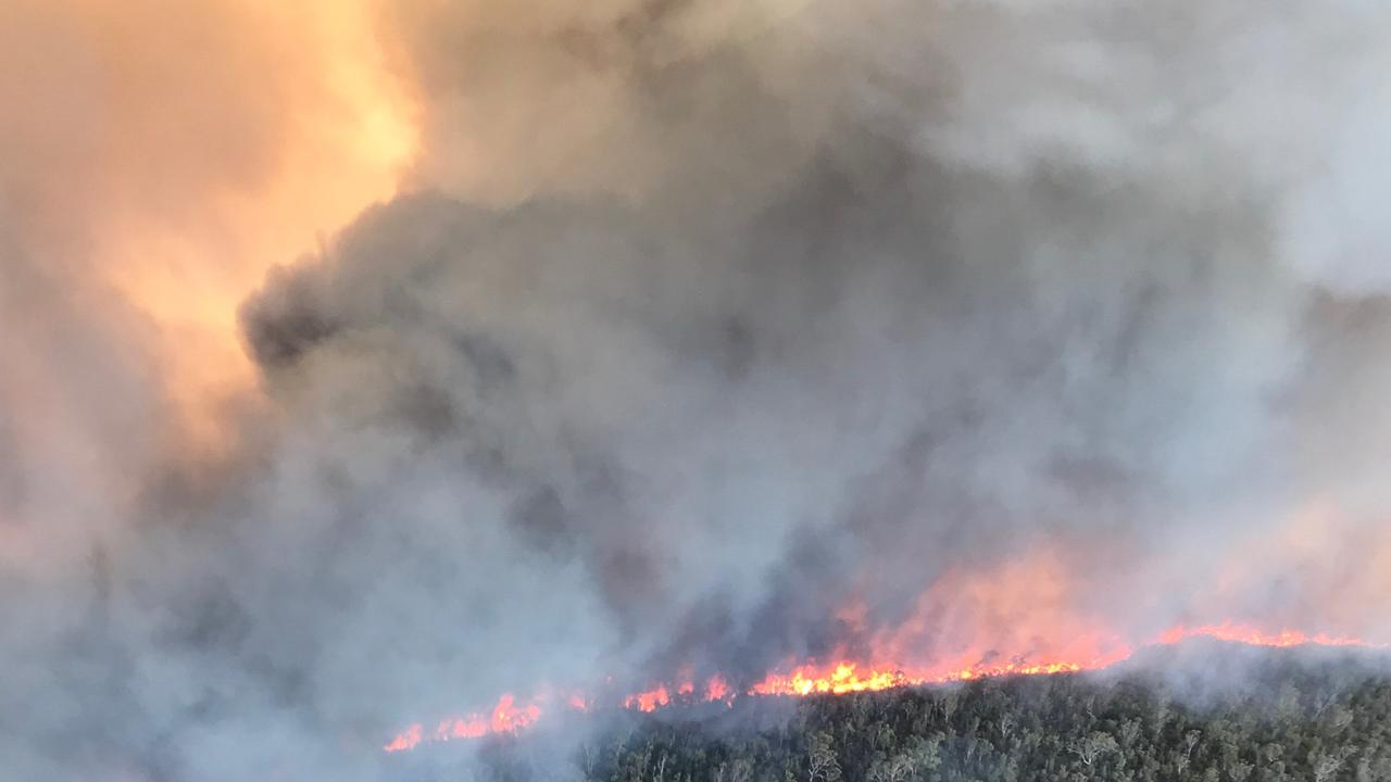 LAST YEAR: Photos of a previous Fraser Island fire taken on December 4 from the air.