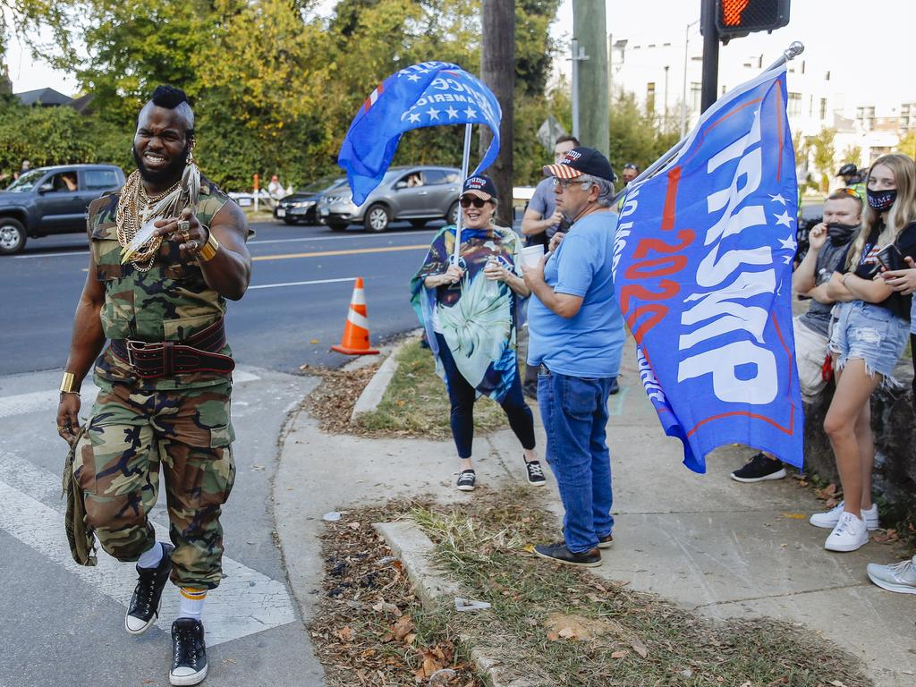 A Mr T impersonator walks past Trump supporters outside the debate venue. Picture: Angus Mordant for News Corp Australia