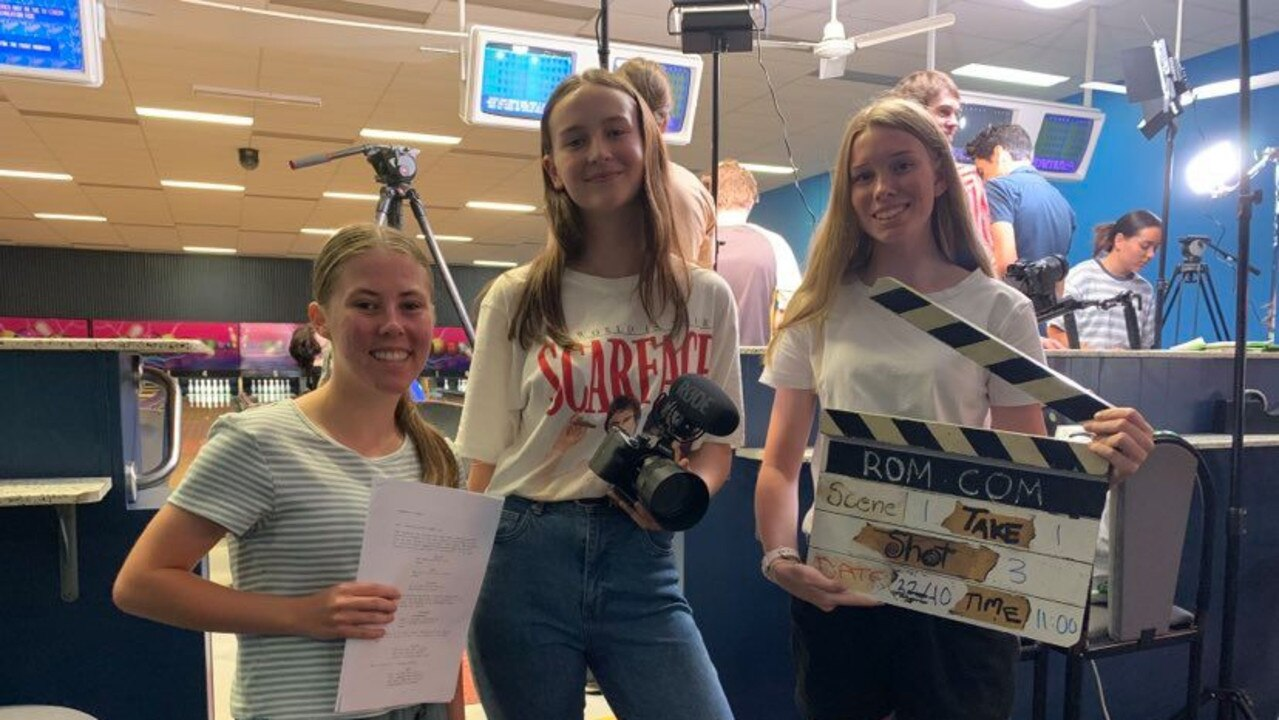 MOVIE MAGIC: (L) Olivia Carmichael from Urangan State High School, Jazmyn Hanily from Xavier Catholic College and Alannah Sauer from Aldridge State High School on the set of the shoot. Photo: Stuart Fast
